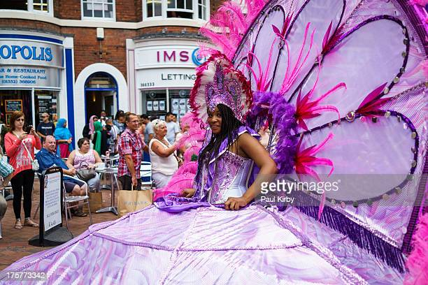 Carnival girl in a large pink and purple Butterfly costume At the Derby Caribbean Carnival 2013