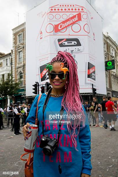 Carnival goer enjoys a Red Stripe lager at the Notting Hill Carnival on August 24 2014 in London England