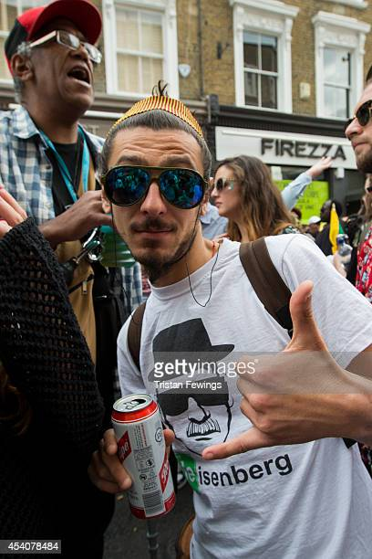 A carnival goer enjoys a Red Stripe lager at the Notting Hill Carnival on August 24 2014 in London England