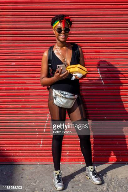 A carnival goer poses during the Notting Hill carnival on August 26 2019 in London England One million people are expected on the streets in...