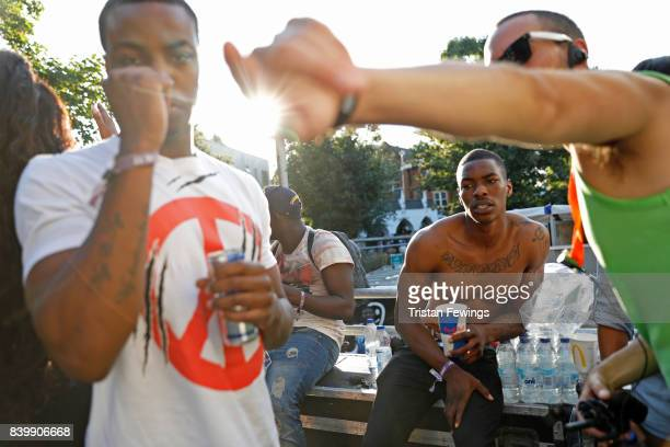 Carnival goers backstage at the 'Red Bull Music Academy Soundsystem' at Notting Hill Carnival 2017 on August 27 2017 in London England