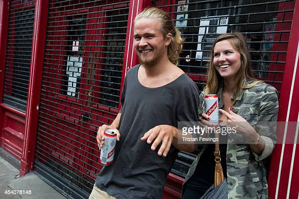 Carnival goers Riko Nyberg and Julian Knorde enjoy a Red Stripe lager at the Notting Hill Carnival on August 24 2014 in London England