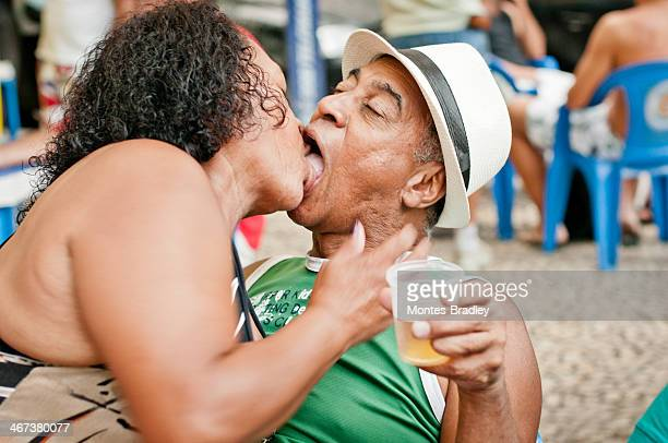 carnival madness - kissing on the mouth stock photos and pictures