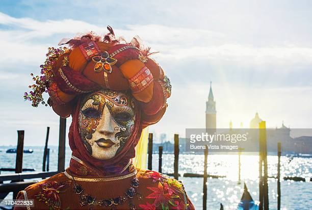 carnival mask in venice posing in san marco square - venice carnival stock pictures, royalty-free photos & images