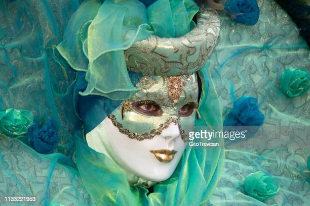carnival masks of venice - metallic dress stock pictures, royalty-free photos & images