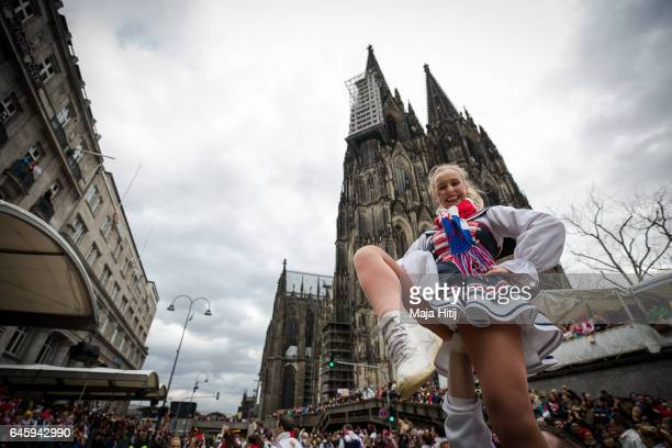 Carnival members dance during Rose Monday parade on February 27 2017 in Cologne Germany Political satire is a traditional cornerstone of the annual...