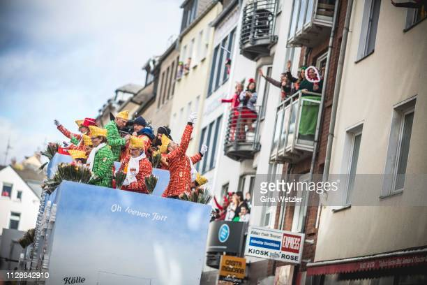 Carnival members throw sweets during Rose Monday Carnival parade on March 4 2019 in Cologne Germany Cities throughout the Rhineland region are...