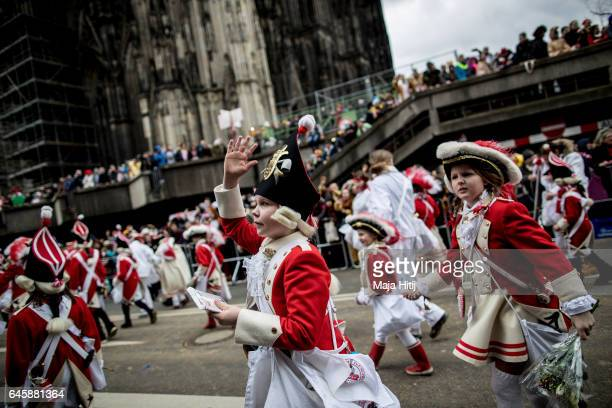 Carnival members throw sweets during Rose Monday parade on February 27 2017 in Cologne next to the Cathedral Germany Political satire is a...