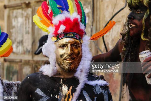 A carnival participant in face paint attends the Zambo carnival held in the northern Lebanese city of Tripoli on March 1 marking the last period of...