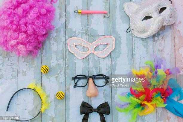 carnival party  items in wooden background.Flat lay