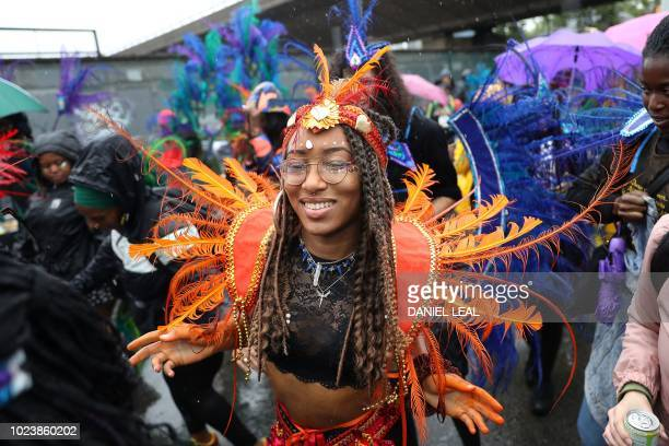 Carnival performer dances during the parade on the first day of the Notting Hill Carnival in west London on August 26, 2018. - Nearly one million...