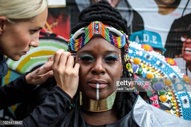 A carnival performer has her makeup done on the final day of the Notting Hill Carnival on August 27 2018 in London England The Notting Hill Carnival...
