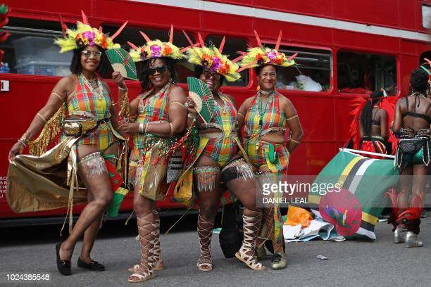 Carnival performers in costume pose for a photograph as they wait in the preparation area ahead of an appearance on the main Parade day of the...