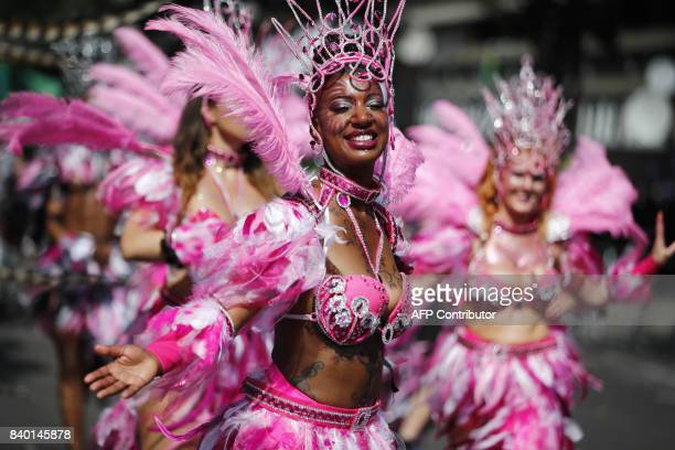 Carnival performers parade in the sunshine on the main Parade day of the Notting Hill Carnival in west London on August 28, 2017. Nearly one million...