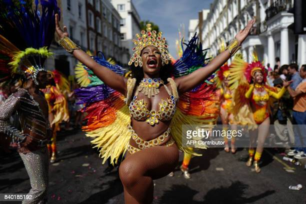 Carnival performers participate in the parade on the main day of the Notting Hill Carnival in west London on August 28 2017 Nearly one million people...
