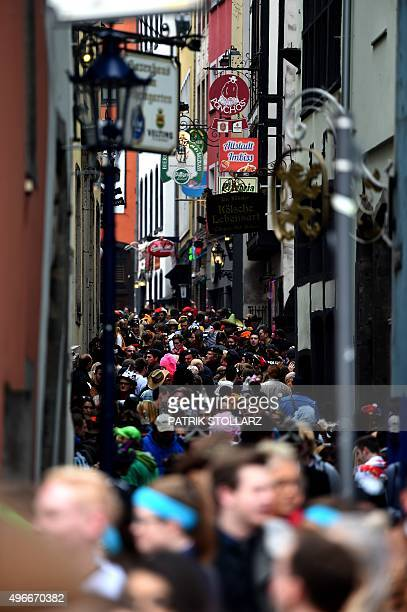 Carnival revellers crowd the street as they celebrate the launch of the socalled 'Fifth Season' the carnival season on November 11 2015 in Cologne...