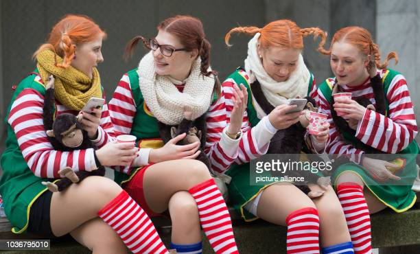 Carnival revellers dressed as Pippi Longstocking attend the traditional carnival parade in OsnabrueckGermany 06 February 2016...