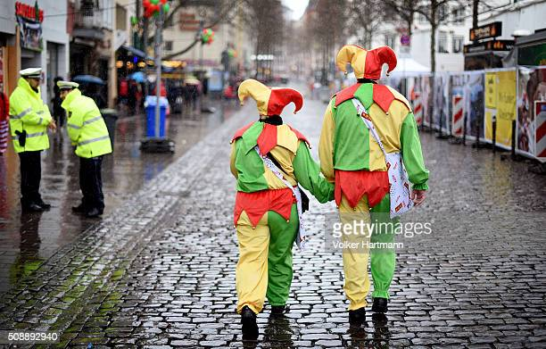 Carnival revellers hide underneath a blind during a carnival parade called Schull un Veedelszoech as part of the carnival season on February 7 2016...