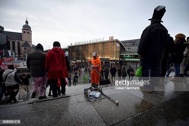 Carnival revellers walk along the Cologne Central Station during Weiberfastnacht celebrations as part of the carnival season on February 4 2016 in...