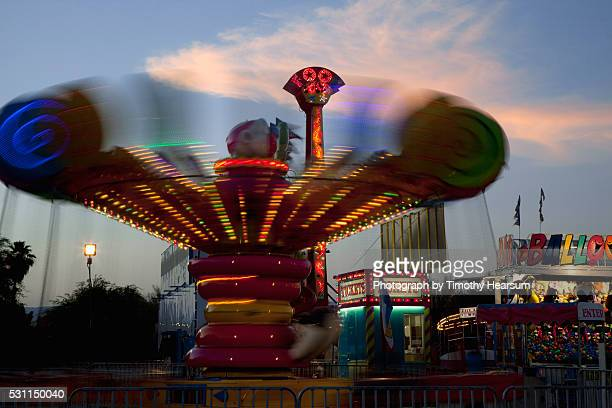 carnival ride at dusk - timothy hearsum stock pictures, royalty-free photos & images