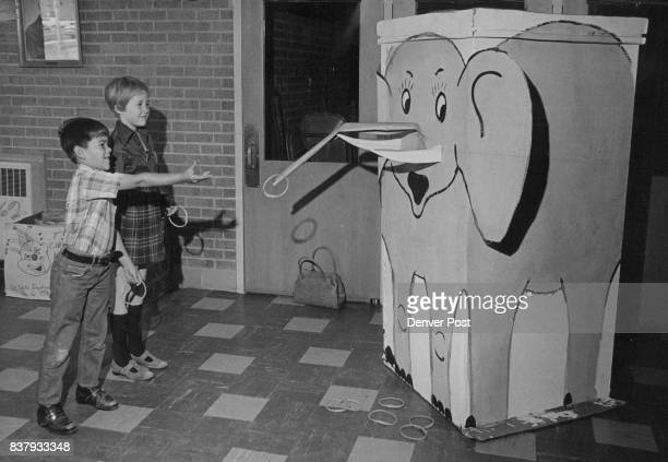 Carnival Ring Toss Targets Gary Fink and Lauri Opperman students at Eiber Elementary School 1395 Independence St Lakewood try to ring the tusks of...
