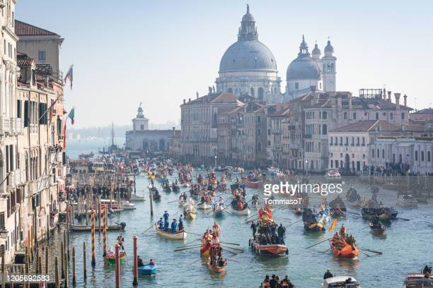 carnival water parade in venice with chiesa della salute in the background - istock images stock pictures, royalty-free photos & images