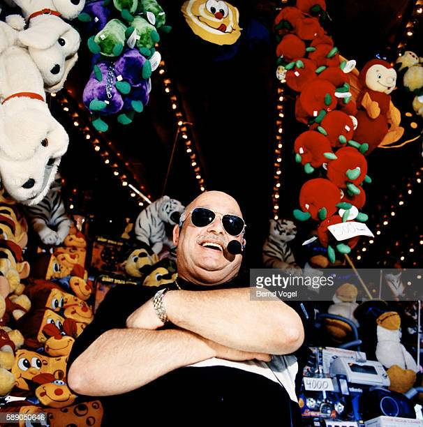 carnival worker in front of toys - best sunglasses for bald men stock pictures, royalty-free photos & images