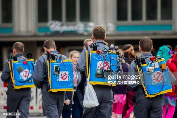 Carnivalists dressed as Ghostbusters celebrate the launch of the carnival season on November 11 2018 in Cologne western Germany Several thousand...