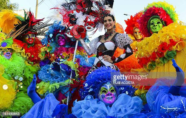 Carnival's Queen Daniela Cepeda poses with dancers during the third day of carnival in Barranquilla Colombia on February 11 2013 Barranquilla's...