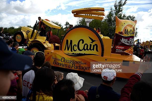 A carnivaltype float of Canadian French fries brand 'McCain' participates in a publicity caravan parade prior to the start of the 188 km first stage...