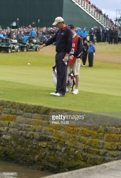 Carnoustie, UNITED KINGDOM: Irish Padraig Harrington drops the ball hitting a shot into the burn on the 18th hole during the final round of the 136th...