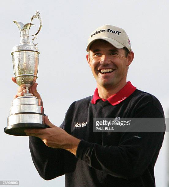 Irish Padraig Harrington holds the trophy after winning the 136th British Open Golf Championship at Carnoustie Scotland 22 July 2007 AFP PHOTO/Paul...