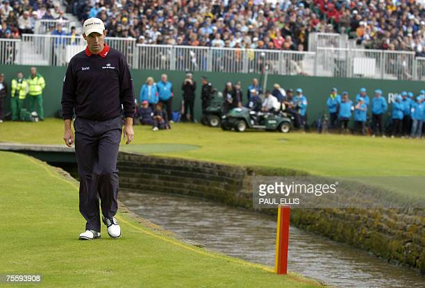 Carnoustie, UNITED KINGDOM: Irish Padraig Harrington walks next to the burn on the 18th during the final round of the 136th British Open Golf...