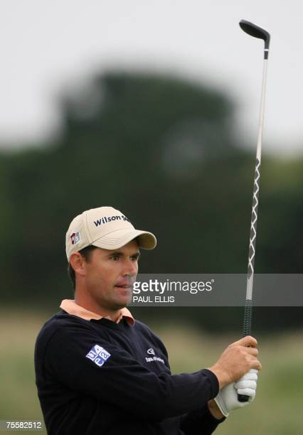 Carnoustie, UNITED KINGDOM: Irish Padraig Harrington watches his tee shot on the third hole during the third round of the 136th British Open Golf...