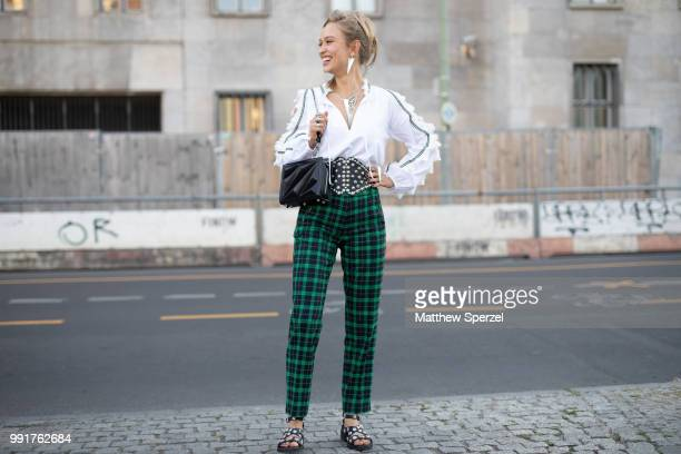 Caro Cult is seen attending Riani wearing green plaid pants with white shirt and studded black belt during the Berlin Fashion Week July 2018 on July...