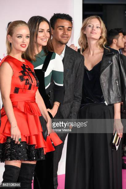 Caro Cult Janina Uhse Langston Uebel and guest attend the 'High Society' Premiere at CineStar on September 5 2017 in Berlin Germany