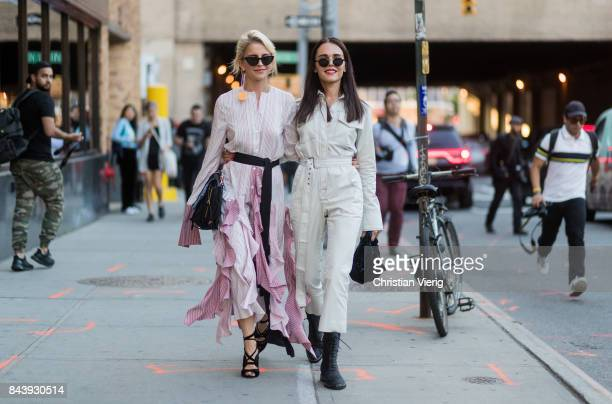 Caro Daur and Evangelie Smyrniotaki seen wearing dress and overall in the streets of Manhattan outside Adam Selman during New York Fashion Week on...