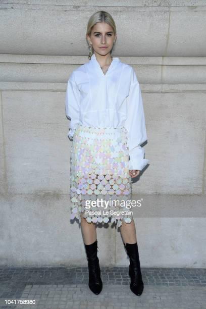 Caro Daur arrives at the Paco Rabanne show as part of the Paris Fashion Week Womenswear Spring/Summer 2019 at Le Grand Palais on September 27, 2018...