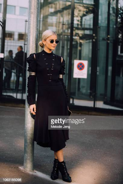 Caro Daur attends the Chloe show in a black dress and boots during Paris Fashion Week Spring/Summer 2019 on September 27 2018 in Paris France