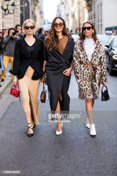 Caro Daur Evangelie Smyrniotaki and Loulou de Saison are seen after the Jacquemus show on September 24 2018 in Paris France