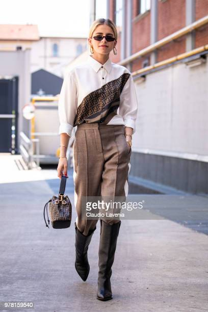 Caro Daur in Fendi total look is seen in the streets of Milan before the Fendi show during Milan Men's Fashion Week Spring/Summer 2019 on June 18...