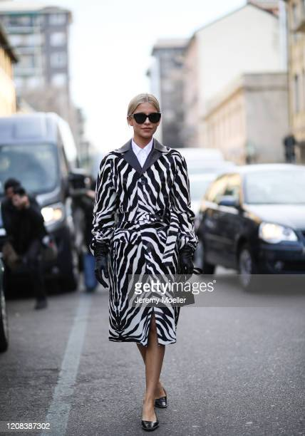 Caro Daur is seen wearing a animal print coat from Tods before Tods during Milan Fashion Week Fall/Winter 2020-2021 on February 21, 2020 in Milan,...