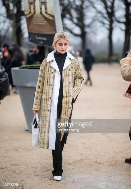 Caro Daur is seen wearing plaid coat, black turtleneck outside Kenzo during Paris Fashion Week - Menswear F/W 2019-2020 Day Six on January 20, 2019...