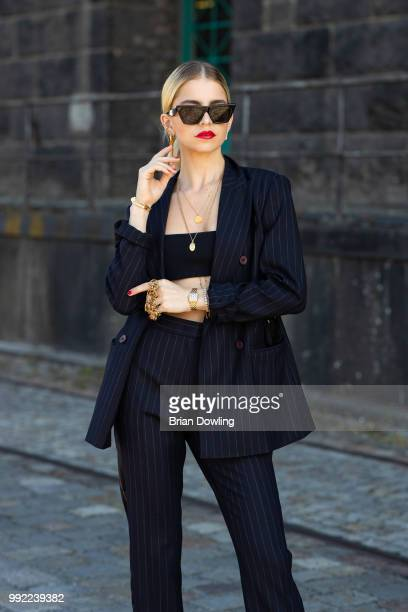 Caro Daur poses during the Marc Cain Street Style shooting at WECC on July 3 2018 in Berlin Germany
