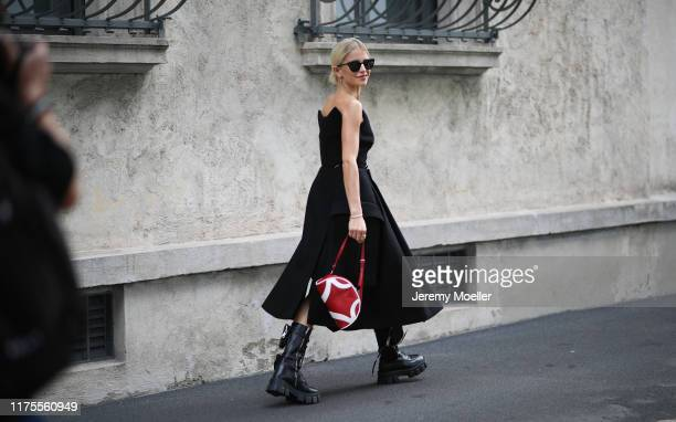 Caro Daur poses outside the Prada show during Milan Fashion Week Spring/Summer 2020 on September 17 2019 in Milan Italy