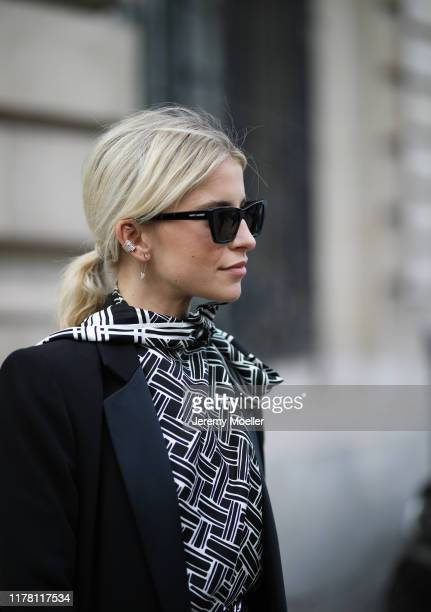 Caro Daur wearing a AirPods Bottega Veneta bag on September 28 2019 in Paris France