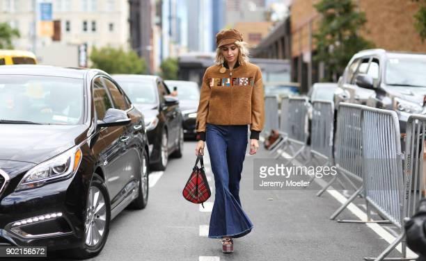 Caro Daur wearing a Fendi jacket Diane von Fürstenberg earring Loewe bag during the New York Fashion Week on September 09 2017 in New York