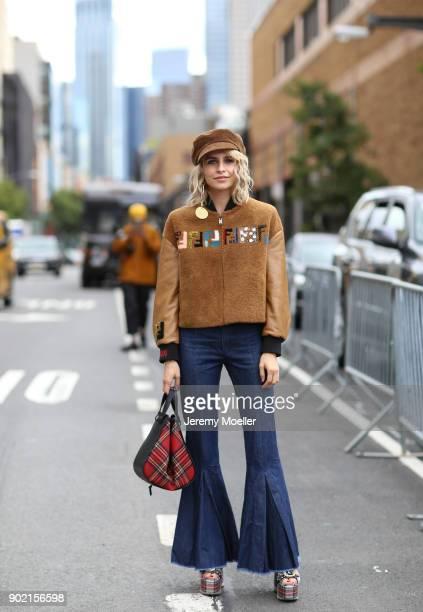 Caro Daur wearing a Fendi jacket, Diane von Fürstenberg earring, Loewe bag during the New York Fashion Week on September 09, 2017 in New York