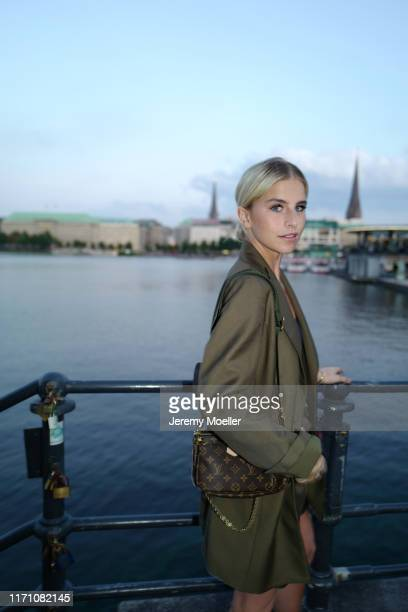 Caro Daur wearing a khaki suit Louis Vuitton Pochette and Cartier jewelry on August 29 2019 in Hamburg Germany