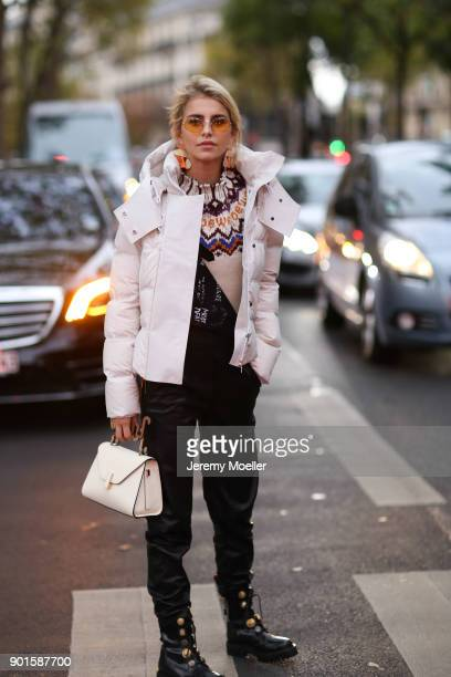 Caro Daur wearing a Loewe sweater Valextra bag Peuterey jacket and Each x Other jeans on September 28 2017 in Paris